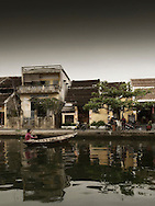 Tiny barge sails on Thu Bon River, Hoi An, Vietnam, Southeast Asia