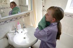 Girl washing her face,