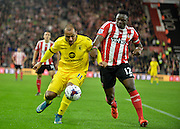Aston Villas Gabriel Agbonlahor and Southamptons Juanmi challenge for the ball during the Capital One Cup match between Southampton and Aston Villa at the St Mary's Stadium, Southampton, England on 28 October 2015. Photo by Adam Rivers.
