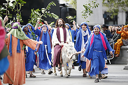 April 14, 2017 - London, London, UK - London, UK. Actors of the Wintershall Players perform 'The Passion of Jesus' on Good Friday to crowds in Trafalgar Square, London on 14 April 2017. The Wintershall Players are based on the Wintershall Estate in Surrey and perform several biblical theatrical productions per year. Their production of 'The Passion of Jesus' includes a cast of 80 actors, horses, a donkey and authentic costumes of Roman soldiers in the 12th Legion of the Roman Army. (Credit Image: © Tolga Akmen/London News Pictures via ZUMA Wire)