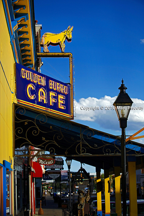 """SHOT 6/20/10 6:51:53 PM - The Golden Burro Cafe and Lounge in Leadville, Co. is a neon-bright, irony-free diner, a place where old-timers sit and drink coffee and dig into gigantic plates of eggs and pancakes. Established in 1938 the Golden Burro Cafe is the kind of place the younger people find """"authentic"""" because it is. Leadville is the county seat of, and the only municipality in, Lake County, Colorado, United States. Situated at an elevation of 10,152 feet (3094 m), Leadville is the highest incorporated city and the second highest incorporated municipality in the United States. A former silver mining town that lies near the headwaters of the Arkansas River in the heart of the Rocky Mountains, the city includes the Leadville Historic District, which preserves many historic structures and sites from Leadville's dynamic mining era. In the late 1800s, Leadville was the second most populous city in Colorado, after Denver. The United States Census Bureau estimates that the city population has shrunk to only 2,688 in 2005. (Photo by Marc Piscotty / © 2010)"""