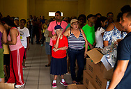 MAUNABO, PUERTO RICO - OCTOBER 9, 2017 - People wait on line to receive water and food supplies at the Matuyas Community Center in Maunabo Puerto Rico, where National Guards helicopters had dropped aid. The center of Hurricane Maria passed here and cause some of the most extensive damage .  (Photo/Jos&eacute; Jim&eacute;nez) Through the Iris of Hurricane Mar&iacute;a<br />