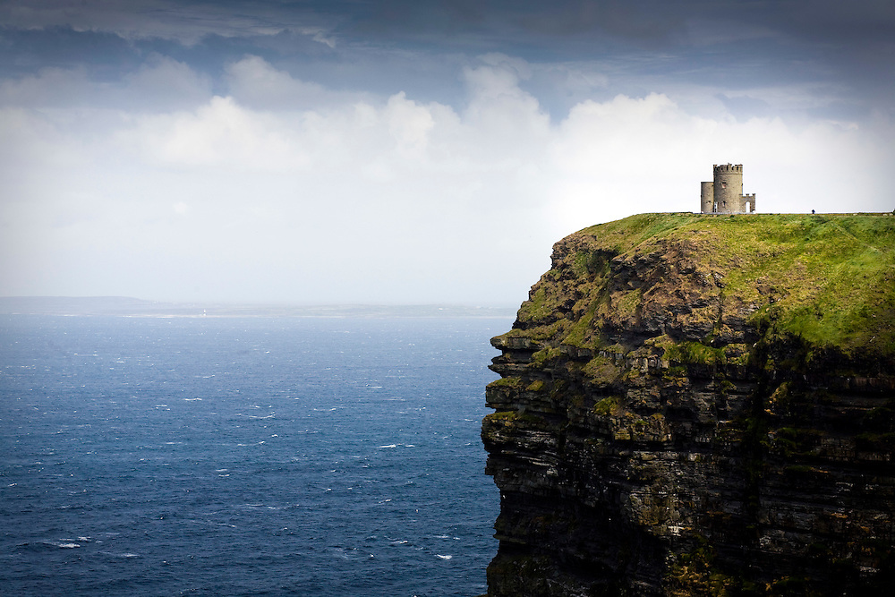 O'Brien's Tower, one of the most popular tourist destinations in Ireland, sits atop the Cliffs of Moher and overlooks Galway Bay in Ireland.