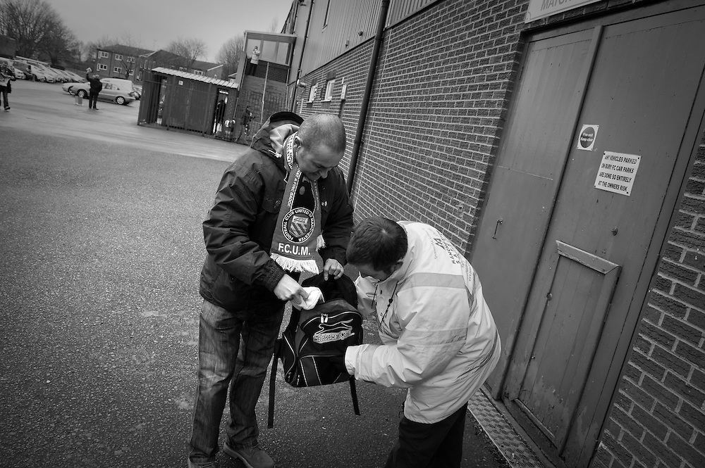 FC United of Manchester play a local team Chorley at Bury football club's ground in Lancashire, Britain. Photos show supporters having a security check before entering the ground.