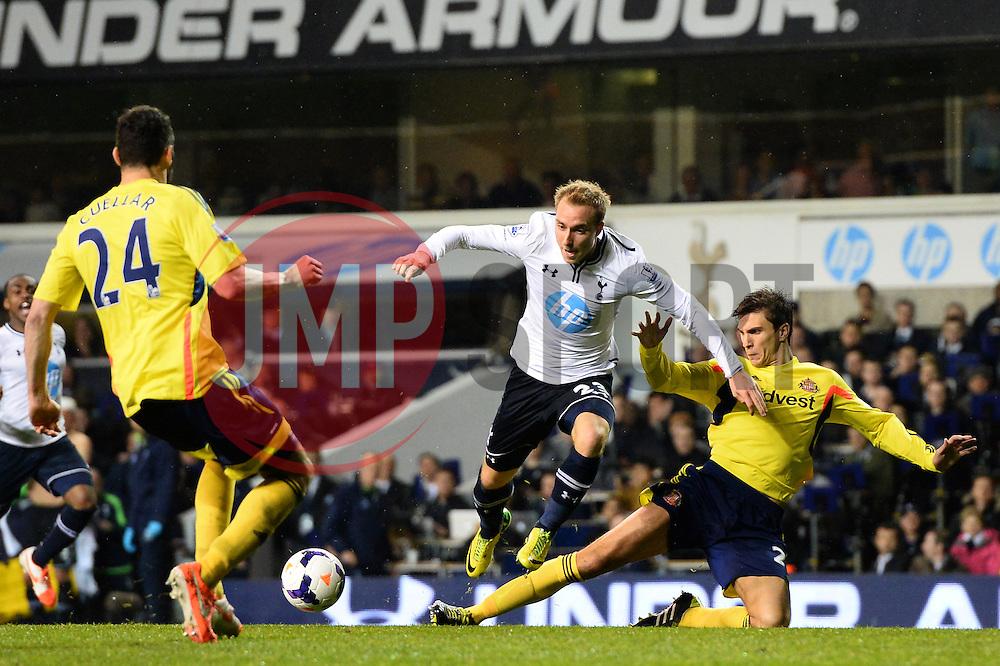 Sunderland's defender Santiago Vergini tackles Tottenham's midfielder Christian Eriksen   - Photo mandatory by-line: Mitchell Gunn/JMP - Tel: Mobile: 07966 386802 07/04/2014 - SPORT - FOOTBALL - White Hart Lane - London - Tottenham Hotspur v Sunderland - Premier League
