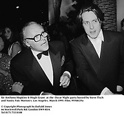 Sir Anthony Hopkins & Hugh Grant  at the  Oscar Night party hosted by Steve Tisch and Vanity Fair. Morton's. Los Angeles. March 1995. Film. 95548/25a<br />