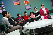 Azita Arif Nazimi, 25, (right) is presenting 'Family Live Show', a television program broadcasted live by Channel 1, an Afghan national television, in Kabul, Afghanistan. Her guest and other members of the show are sitting near Azita. .