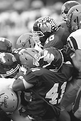 12 November 2011:  A major pile up of both lines during an NCAA division 3 football game between the Augustana Vikings and the Illinois Wesleyan Titans in Tucci Stadium on Wilder Field, Bloomington IL