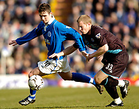 Photo: Richard Lane.<br />Birmingham City v Leicester City. FA Barclaycard Premiership. 13/03/2004.<br />Hughes is challenged by Ben Thatcher.