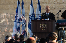 Israeli President Shimon Peres addresses a joint funeral for the three Israeli teens at a cemetery in Modi'in near Jerusalem, on July 1, 2014. The three Israeli teens whose bodies were found Monday evening were brought to rest side by side on Tuesday at a joint funeral held in Modi'in near Jerusalem. Tens of thousands of people participated in the funeral, including Prime Minister Benjamin Netanyahu and President Shimon Peres, who eulogized the three, whose caskets were wrapped with Israeli flags. EXPA Pictures © 2014, PhotoCredit: EXPA/ Photoshot/ Li Rui<br /> <br /> *****ATTENTION - for AUT, SLO, CRO, SRB, BIH, MAZ only*****