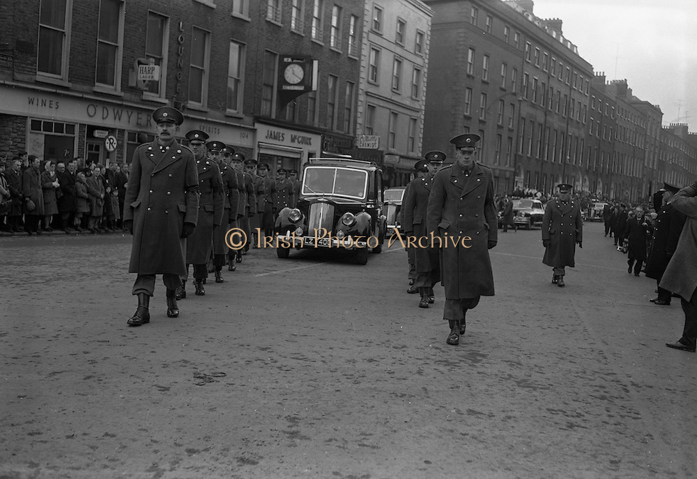 The scene in O'Connell Street as thousands of people lined the street for the funeral of Cardinal D'Alton. 600 troops of the army and the No. 1 Army Band head the cortege. The cardinal was buried in St Patrick's Cathedral, Armagh. <br /> 02.02.1963