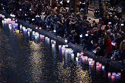"People set afloat lanterns during a lantern ceremony given by the association ""ToujoursParis.fr"" at the Canal St Martin in Paris, France, on November 13, 2016. Photo by Eliot Blondet/ABACAPRESS.COM"