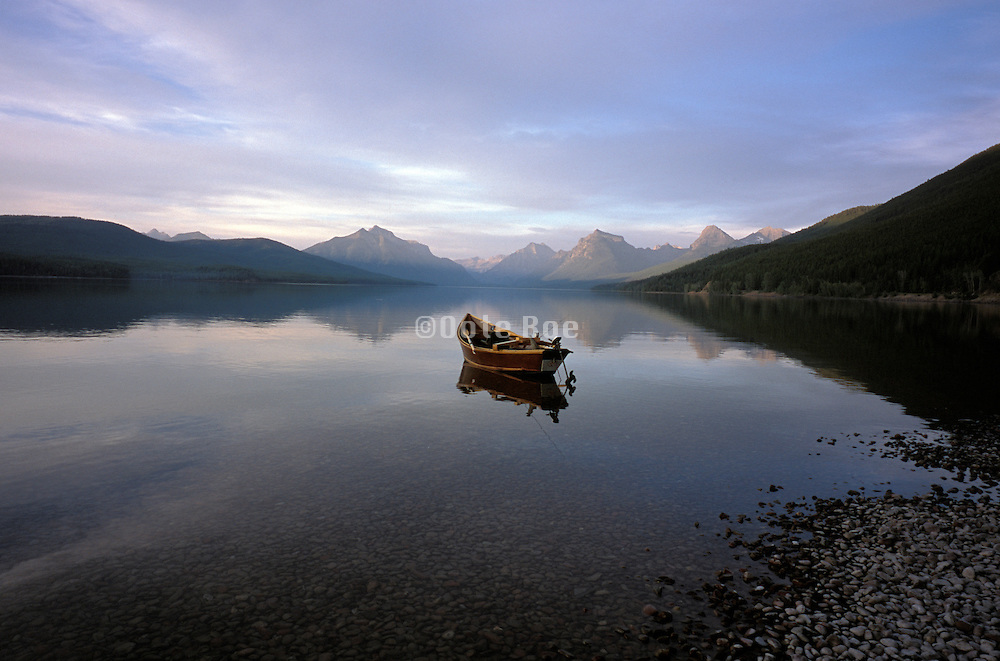 panoramic view of empty boat on lake McDonald at Glacier National Park USA