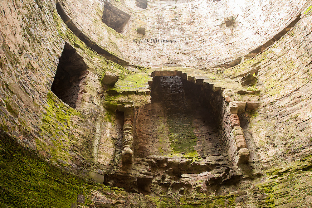 Views of the ruins of Conwy Castle, Conwy, Wales. Interior from below showing empty fireplace in the royal quarters.