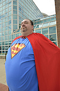 Garden City, New York, U.S. - June 14, 2014 - Man is dressed as Superman, in a red cape, and blue red and yellow top, at Eternal Con, the annual Pop Culture Expo, with costumes, Comic Books, Collectibles, Gaming, Sci-Fi, Cosplay, Horror, and held at the Cradle of Aviation Museum on Long Island.