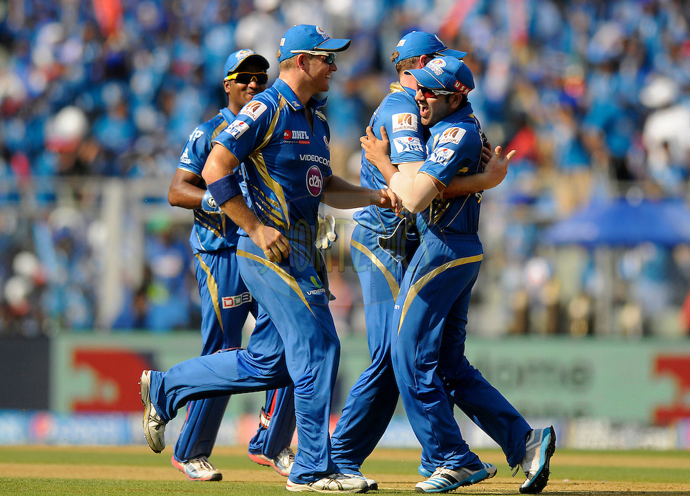 Rohit Sharma captain of the Mumbai Indians celebrates after getting Virender Sehwag of the Kings X1 Punjab run out during match 22 of the Pepsi Indian Premier League Season 2014 between the Mumbai Indians and the Kings XI Punjab held at the Wankhede Cricket Stadium, Mumbai, India on the 3rd May  2014<br /> <br /> Photo by Pal Pillai / IPL / SPORTZPICS<br /> <br /> <br /> <br /> Image use subject to terms and conditions which can be found here:  http://sportzpics.photoshelter.com/gallery/Pepsi-IPL-Image-terms-and-conditions/G00004VW1IVJ.gB0/C0000TScjhBM6ikg