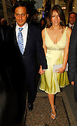 24.MAY.2007. LONDON<br /> <br /> LIZ HURLEY AND HUSBAND ARUN LEAVING CROCKFORD&rsquo;S IN MAYFAIR AFTER ATTENDING THE LAUNCH OF LUXURY PUBLISHING COMPANY SPEAR MEDIA&rsquo;S NEW RACING MAGAZINE THE DERBY, THEY THEN WENT ONTO THE DORCHESTER FOR DINNER WITH TRINNY WOODALL AND HER HUSBAND, TRINNY LEFT AT 10.30PM AND LIZ AND ARUN LEFT VIA THE GARAGE AT 11.45PM AND WENT HOME.<br /> <br /> BYLINE: EDBIMAGEARCHIVE.CO.UK<br /> <br /> *THIS IMAGE IS STRICTLY FOR UK NEWSPAPERS AND MAGAZINES ONLY*<br /> *FOR WORLD WIDE SALES AND WEB USE PLEASE CONTACT EDBIMAGEARCHIVE - 0208 954 5968*