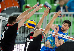 Alexandre Ferreira and Marcel Gil Keller of Portugal vs Mitja Gasparini of Slovenia during volleyball match between National teams of Slovenia and Portugal in 2nd Round of 2018 FIVB Volleyball Men's World Championship qualification, on May 26, 2017 in Arena Stozice, Ljubljana, Slovenia. Photo by Vid Ponikvar / Sportida