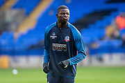 Yoan Zouma of Bolton Wanderers warming up before the EFL Sky Bet League 1 match between Bolton Wanderers and Milton Keynes Dons at the University of  Bolton Stadium, Bolton, England on 16 November 2019.