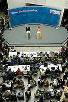 30 MAY 2005, BERLIN/GERMANY:<br /> Edmund Stoiber (L), CSU, Ministerpraesident Bayern, und Angela Merkel (R), CDU Bundesvorsitzender, waehrend einer Pressekonferenz zur Nominierung von Angela Merkel als Kanzlerkandidatin der CDU/CSU in der bevorstehenden Bundestagswahl durch eine gemeinsamen Praesidiumssitzung von CDU und CSU, Bundesgeschaeftsstelle der CDU<br /> IMAGE: 20050530-04-021<br /> KEYWORDS: Übersicht, Uebersicht, Journalisten