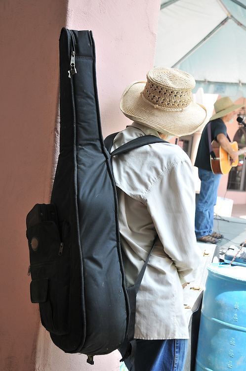Musician waits off stage during the 2013 Tucson Folk Festival. Event photography by Martha Retallick.