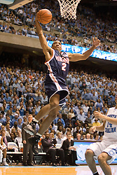 J.R. Reynolds (2) dunks against the University of North Carolina at the end of the first half. Despite Reynolds' team-high 15 points, the #1 ranked Tar Heels beat the Cavaliers 79-69 to improved to 15-1 overall, 2-0 ACC on January 10, 2007 at the Dean Smith Center in Chapel Hill, NC.<br />