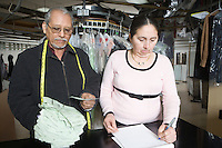 Mature couple working in laundrette