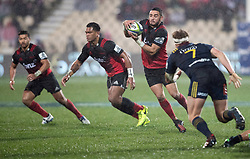 Crusaders Bryn Hall, centre, receives a pass as Highlanders James Lentjes, right, lines up a tackle in the Super Rugby quarter final match, AMI Stadium, Christchurch, New Zealand, July 22 2017.  Credit:SNPA / Adam Binns ** NO ARCHIVING**