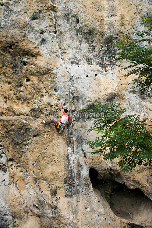 A man rock climbing on a Karst formation in Yangshuo, China (Model Released, Li Shengiang)