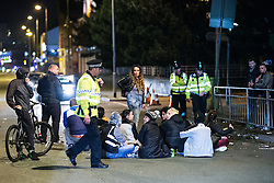 © Licensed to London News Pictures . 15/09/2015. Manchester, UK . Scene on Bury New Road , outside HMP Manchester (formerly Strangeways Prison ) where protesters are blocking the road , playing music and dancing in the road as Stuart Horner continues his protest on the roof of HMP Manchester . Photo credit : Joel Goodman/LNP