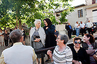 "PERDASDEFOGU, SARDINIA, ITALY - 30 JUNE 2013: Women gather outside St. Peter's church after the mass celebrating Claudina Melis' 100th birthday in Perdasdefogu, Italy, on June 30th 2013.<br /> <br /> Last year, the Melis family entered the Guinness Book of World Records for having the highest combined age of any nine living siblings on earth — today more than 825 years. The youngest sibling, Mafalda – the ""little one"" – is 79 years old.<br /> <br /> The Melis siblings were all born in Perdasdefogu to Francesco Melis and Eleonora Mameli, who had a general store. Consolata, 106, is the oldest, then Claudia, 100; Maria, 98; Antonino, 94; Concetta, 92; Adolfo, 90; Vitalio, 87; Fida Vitalia, 81; and Mafalda, the baby at 79. Their descendants now account for about a third of the village."