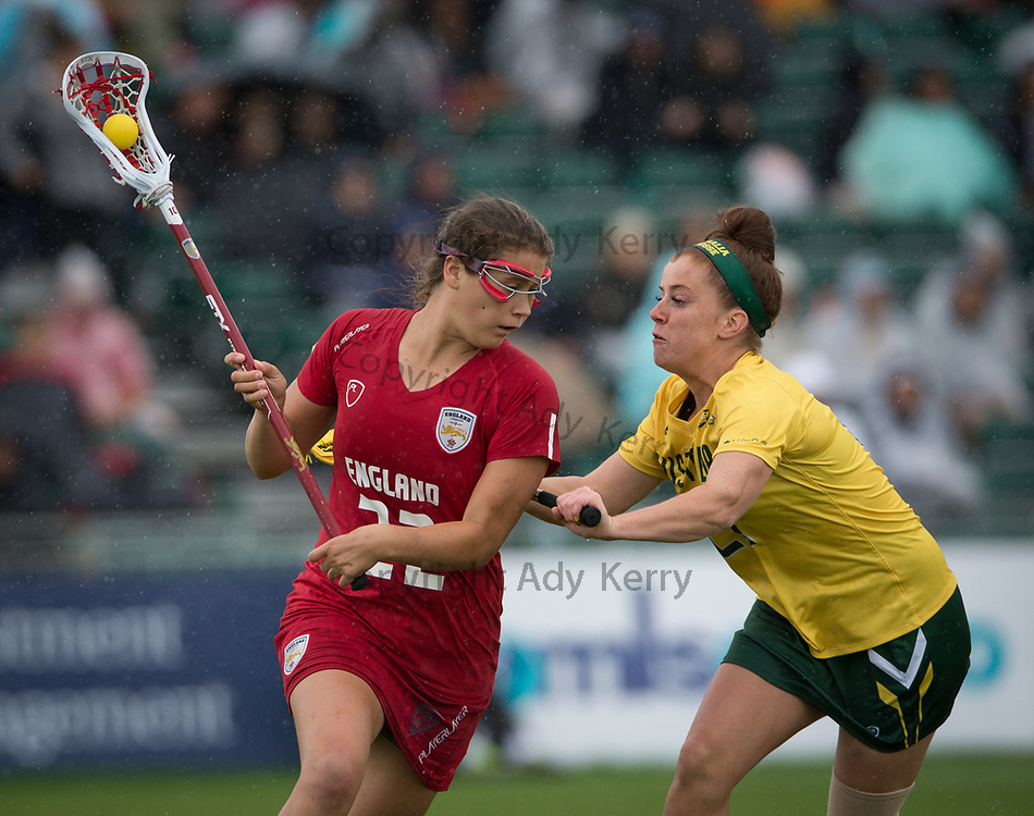 England's Olivia Hompe challenges with Australia's Lauren Hunter in the bronze medal match which they won with a Golden Goal in extra time at the 2017 FIL Rathbones Women's Lacrosse World Cup, at Surrey Sports Park, Guildford, Surrey, UK, 22nd July 2017.