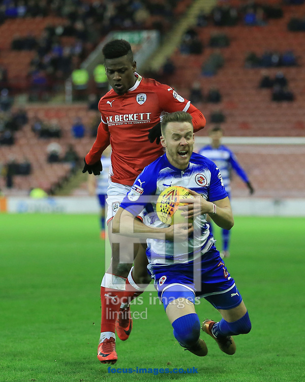 Mamadou Thiam of Barnsley fouls Chris Gunter of Reading during the Sky Bet Championship match at Oakwell, Barnsley<br /> Picture by Mark Cosgrove/Focus Images Ltd 07482 239581?<br /> 30/12/2017