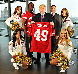 26.10.2010, City Hall, London, ENG, NFL, Photocall San Francisco 49ers and 49ers Goldrush Cheerleader, to Promote the NFL Game between Denver Broncos and the San Francisco 49ers to be played at Wembley Stadium, im Bild Boris Johnson(C) Mayor of London is presented with his own named playing shirt by player Shawntee Spencer (L) and Jed York (R)owner of the 49ers together with the 49ers Goldrush Cheerleaders with Tower Bridge in the background. EXPA Pictures © 2010, PhotoCredit: EXPA/ IPS/ Sean Ryan +++++ ATTENTION - OUT OF ENGLAND/UK +++++