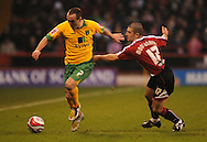 Sheffield - Saturday January 9th, 2009: Nick Montgomery of Sheffield United and Lee Croft of Norwich City during the Coca Cola Championship match at Bramall Lane, Sheffield. (Pic by Alex Broadway/Focus Images)