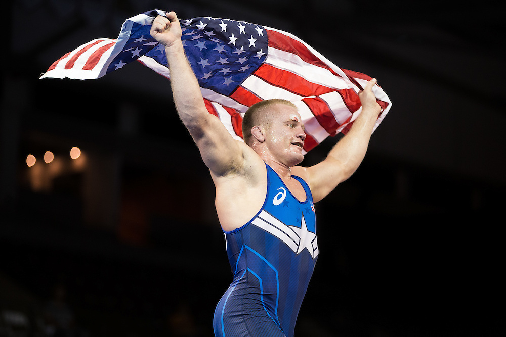 Jon Anderson of the United States celebrates his Gold medal win over Querys Perez of Venezuela in the 85kg class of the men's greco-roman wrestling at the 2015 Pan American Games in Toronto, Canada, July 15,  2015.  AFP PHOTO/GEOFF ROBINS