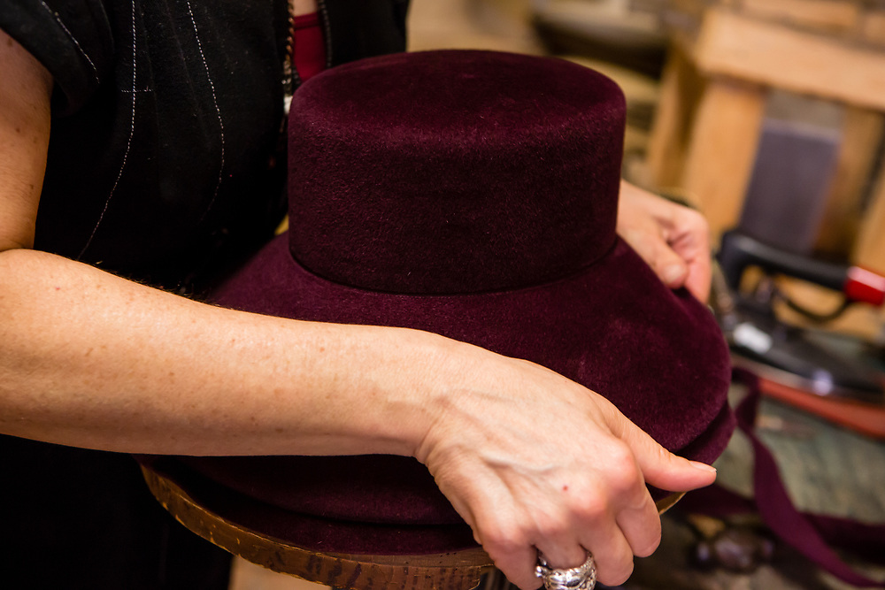 Removing a trimmed hat from a block.