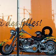 BEIRUT,LEBANON - MAY 2009 : Reflections of the buildings under construction in the shop  window of Plum's fashion store  decorated with a motorcycle in Central District. Beirut.Lebanon. 05/29/2009 ( Photo by Jordi Cami )
