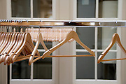 empty coat rack with wooden clothing hangers