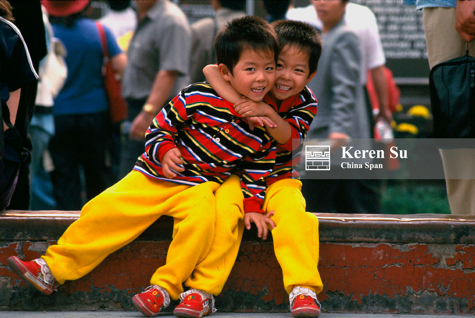 Twin boys by the street, Beijing, China