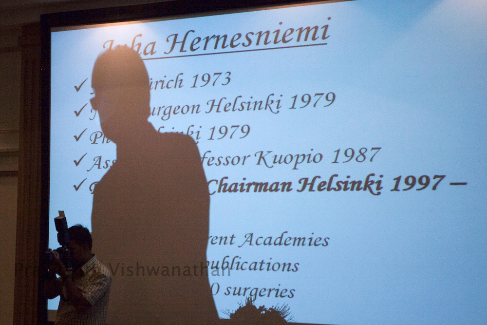 Professor, Juha Hernesniemi's shadow is seen on the projection screen, prior to lecturing and performing three neurosurgeries in front of 170 Indian neurosurgeons at Bombay Hospital in Mumbai, India, on Sunday, April 17, 2011. Photographer: Prashanth Vishwanathan/HELSINGIN SANOMAT