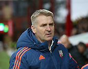 Brentford manager Dean Smith looking pensive during the Sky Bet Championship match between Brentford and Milton Keynes Dons at Griffin Park, London, England on 5 December 2015. Photo by Matthew Redman.