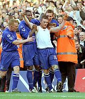 Wayne Rooney (Everton) celebrates his goal with Mark Pembridge (left) Joseph Yobo and Alan Stubbs. Arsenal v Everton. 23/3/03. Credit : Colorsport/Andrew Cowie.