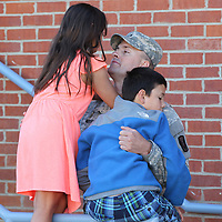 Lt. Stephen Nolen of Mrytle gets a few minutes alone with his children, Stephenie, 8, left, and son, Collin, 9, before beginning a 10 month deployment to Kosovo in support of Operation Joint Guardian.