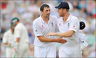 Steve Harmison is congratulated by Andrew Flintoff after getting two wickets in an over during the fourth Test at the Oval on the 7th of August 2008..England v South Africa .Photo by Philip Brown.www.philipbrownphotos.com