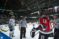 KELOWNA, CANADA - MARCH 18: Linesman Ward Pateman stands between Evan Wardley #27 of Seattle Thunderbirds and Tyrell Goulbourne #12 of Kelowna Rockets on March 18, 2015 at Prospera Place in Kelowna, British Columbia, Canada.  (Photo by Marissa Baecker/Shoot the Breeze)  *** Local Caption *** Ward Pateman; Evan Wardley; Tyrell Goulbourne;