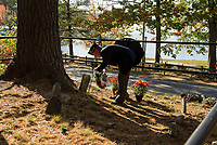 American Legion Post 1 Commander Raymond Peavey Jr. lays a wreath on the grave of Thornton Langley during the dedication ceremony on Saturday morning.  (Karen Bobotas/for the Laconia Daily Sun)