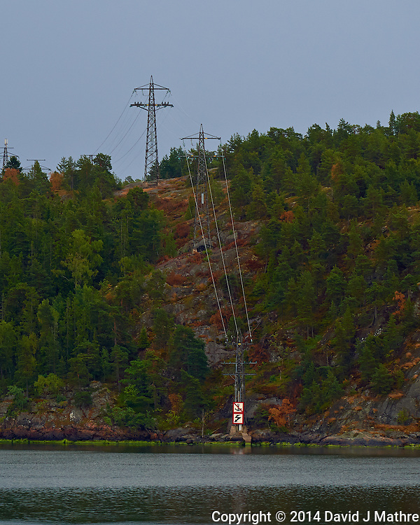Power Lines into the Water. Departing Stockholm, Sweden. Semester at Sea, Summer 2014 Voyage. Image taken with a Nikon Df camera and 70-200 mm f/4 VRII lens (ISO 400, 200 mm, f/5.6, 1/125 sec). Raw image processed with Capture One Pro, Focus Magic, and Photoshop CC 2014.