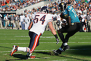 JACKSONVILLE, FL - DECEMBER 12:  Wide receiver Reggie Williams #11 of the Jacksonville Jaguars caught four passes for 62 yards including this six yard touchdown pass in the first quarter while defended by Brian Urlacher #54 of the Chicago Bears on December 12, 2004 at Alltel Stadium in Jacksonville, Florida. The Jags defeated the Bears 22-3. ©Paul Anthony Spinelli *** Local Caption *** Reggie Williams;Brian Urlacher