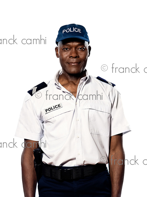 Portrait of an afro American mature police officer standing in studio on white isolated background